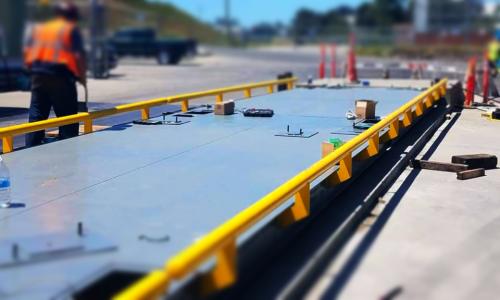 Technician installing a truck scale